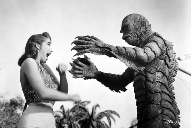 """The Academy of Motion Picture Arts and Sciences will host a month-long series of screenings of classic horror films with """"Universal's Legacy of Horror"""" in October. The series is part of the studio's year-long 100th anniversary celebration engaging Universal's fans and all movie lovers in the art of moviemaking. Pictured: Julie Adams and the Gill Man in CREATURE FROM THE BLACK LAGOON, 1954."""